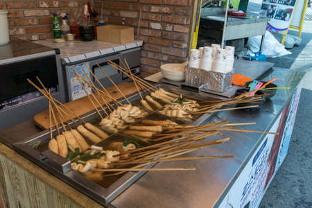BUSAN, SOUTH KOREA - JULY 20, 2017 : Odeng skewers in the hotpot at a shop in traditional market place at Haedong Yonggungsa Temple  in Busan, South Korea, Busan, South Korea.