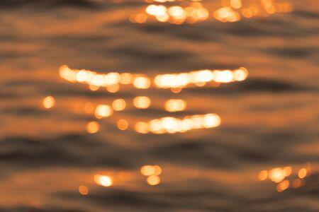Bokeh of beautiful water ripple in the sea when sunset