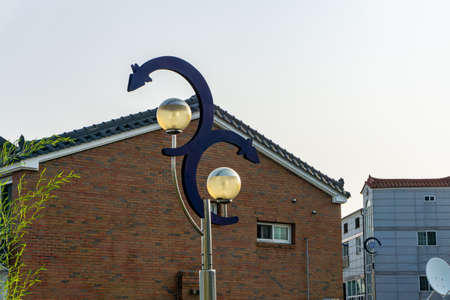 The iconic electricity post made into the eel fish shape to represent the street of eel fish restaurant in Gimhae, Gyeongsangnam-do, South Korea.