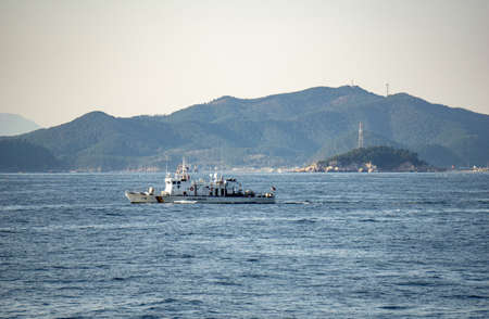 GEOJE, SOUTH KOREA - OCTOBER 20, 2018: Haenuri Class hull number 116, The South Korea coast guard patrol boat sails along the sea near Geoje Island coast.
