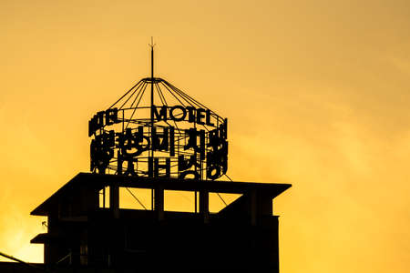 GEOJE, SOUTH KOREA - JUNE 15, 2017: Silhouette of Motel sign on the top of the building in Okpo, Geoje island, South Korea.