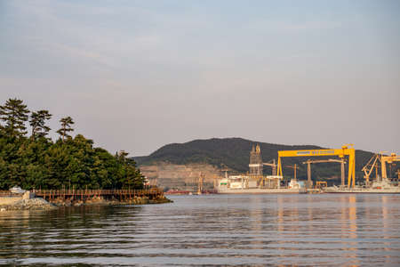GEOJE, SOUTH KOREA - JUNE 15, 2017: View of DSME harbour and the waterside walkway in Okpo, Geoje island, South Korea. Redakční