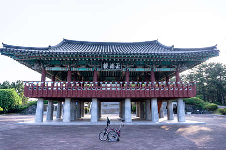 GEOJE, SOUTH KOREA - JUNE 14, 2017 : Brompton folding bike parks in front of a traditional Korean style pavilion.