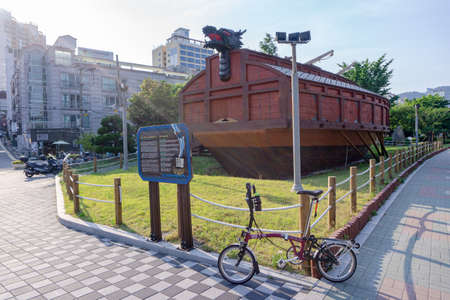 GEOJE, SOUTH KOREA - JUNE 15, 2017: Brompton folding bike park in front of Geobukseon or Korean traditional turtle warship.
