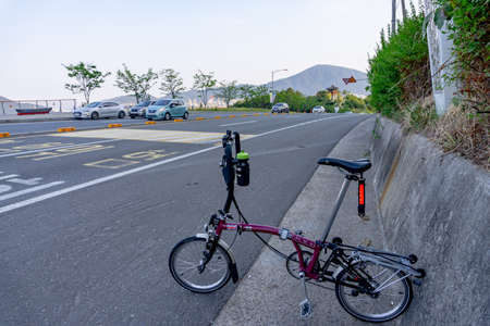 GEOJE, SOUTH KOREA - JUNE 14, 2017 : Brompton folding bike parks on the road in Okpo,Gyeongsangnam-do,South Korea.