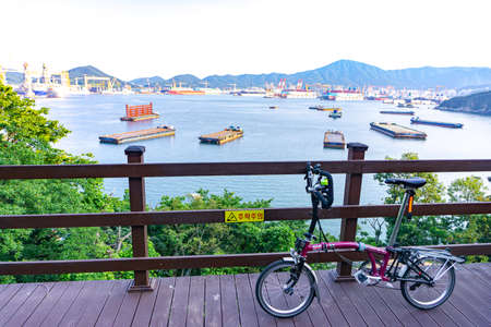 GEOJE, SOUTH KOREA - JUNE 14, 2017 : Brompton folding bike parks in front of DSME harbour in Okpo, South Korea.