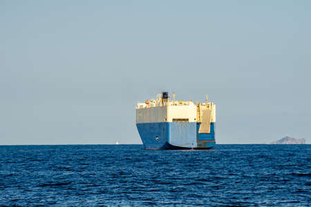 Large White and blue Roll-on/roll-off (RORO or ro-ro) ships or oceangoing vehicle carrier ship anchor in the open sea. Roro ship designed to carry wheeled cargo such as cars, trucks, trailers, etc. Reklamní fotografie