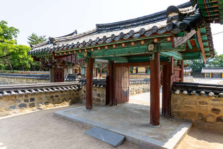 GIMHAE, SOUTH KOREA - JUNE 18, 2017 : Sectional gate of Royal tomb of king Suro of Gaya kingdom in Gimehae, South Gyeongsang province, South Korea.