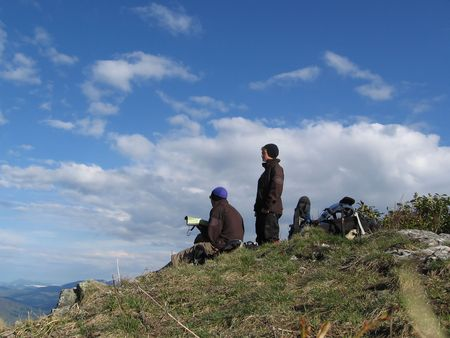 Tourists on the summit in Caucasus mountains Stock Photo - 405928