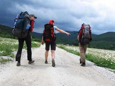 Three tourists on the road Stock Photo - 435173