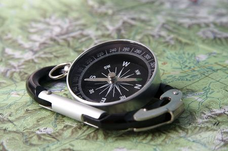 orienting: Black compass and black carabiner