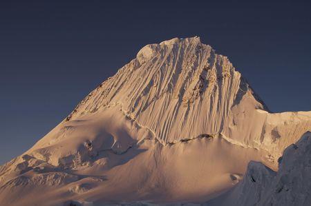 alpamayo: Beautiful summit Alpamayo on the sunset Stock Photo