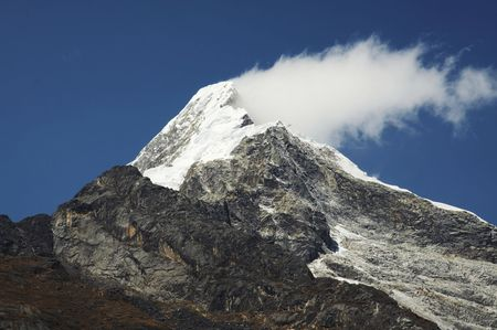 Mountain peak and cloud Stock Photo - 555243