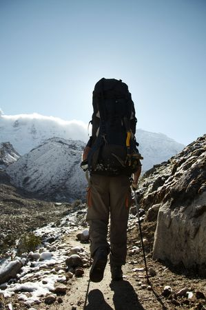 Male going along trail in the Cordillera mountain photo