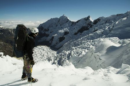 Climber standing on the glacier Stock Photo - 555171