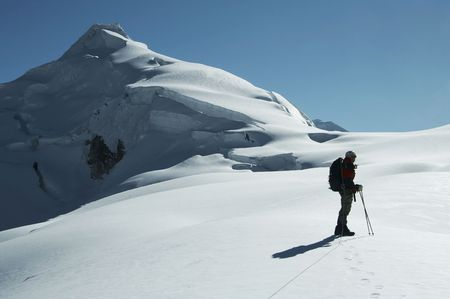 Silhouette climber on the peak Ishinca photo