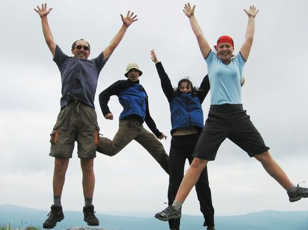 four jumping people Stock Photo