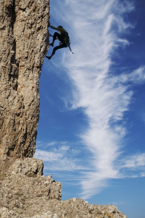 Climber silhouette on the rock photo