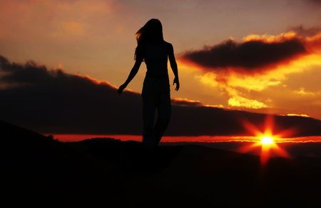 happiness people silhouette on the sunset: Girl silhouette on the sunset background Stock Photo