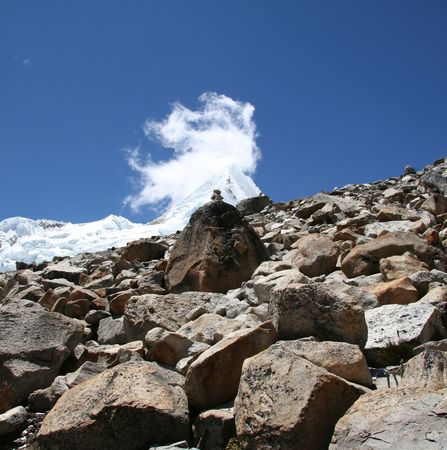 Snowcowered high cordillera mountain and stone photo