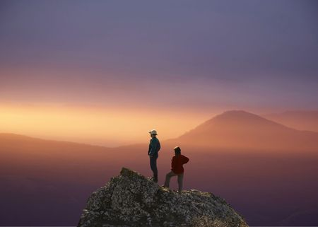 an overview: Men and women overview sunset landscape Stock Photo