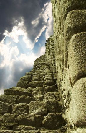 the lost city of the incas: Stone staircase and storm clouds in Machu-Picchu city Stock Photo