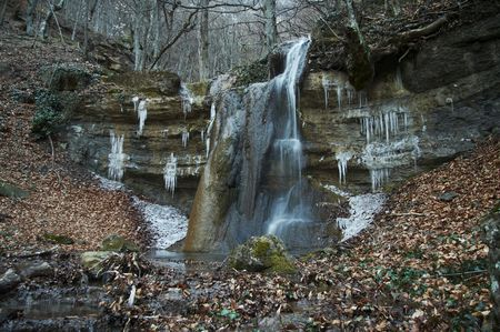 Waterfall in the Crimean forest photo