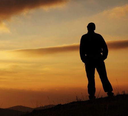 Men silhouette on the sunset Stock Photo