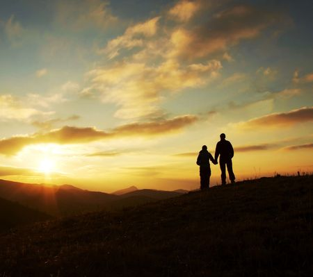 Girl and boy silhouette on the sunset background Stock Photo - 713508