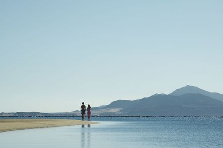 Girl and boy going up along Red sea coastlines photo