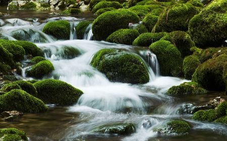 bourn: Waterfall movement on the stone background Stock Photo