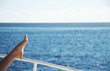 Pelaxing woman on the yacht in sea photo