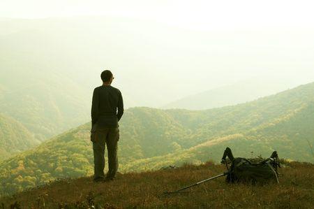 Alone man overview autumn landscape photo