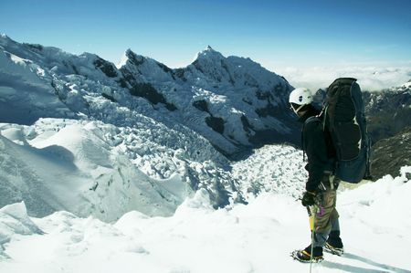 Climber standing on the glacier photo