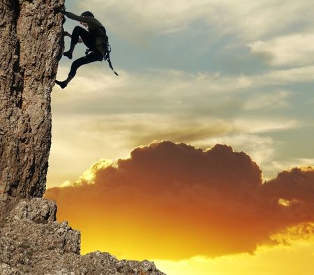 girl climbing on the rock on sunset background Stock Photo - 738864