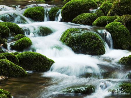 Waterfall movement on the stone background photo