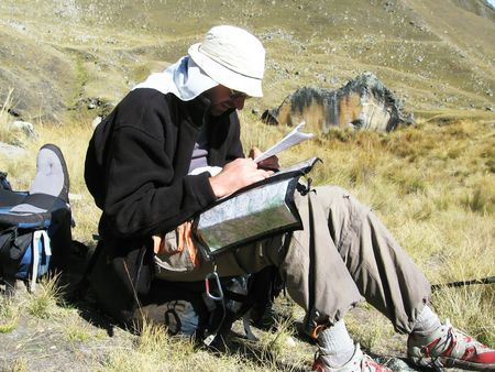 male looling maps in Cordilleras mountain photo