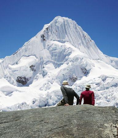 alpamayo: Girl and boy are looking to Alpamayo peak