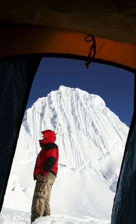 Climber on bakcground Alpamayo peak photo