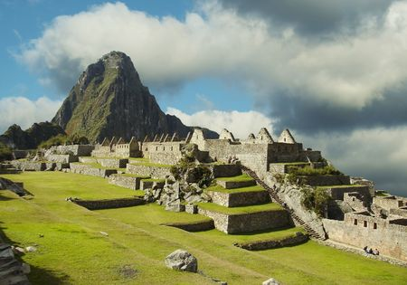 the lost city of the incas: Building in Machu-Picchu city,green grass and blue