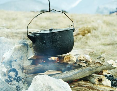 Campfire and kitchenware in mountain Stock Photo - 785087