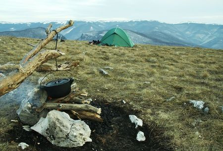 Campfire,kitchenware and tent in camping Stock Photo - 785052