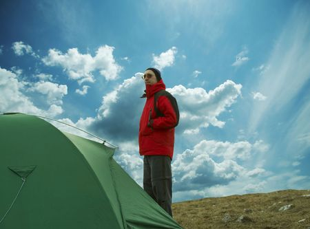Green tent and man on red jaket Stock Photo - 784087