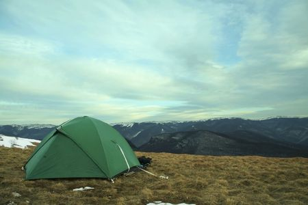 Green tent on grassland in Crimean mountain Stock Photo - 784888