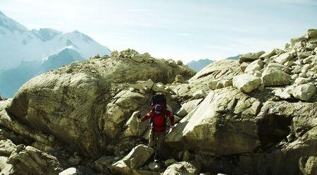 Climber the climb on big stone photo