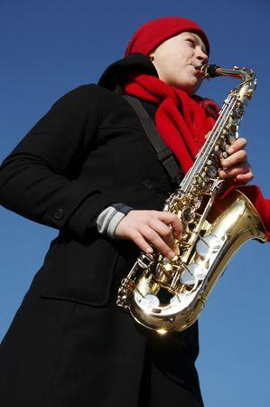 dance preteen: Beautiful girl plays on a saxophon