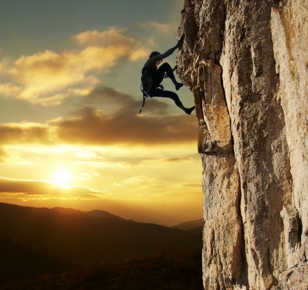 girl climbing on the rock on sunset background Stock Photo - 813811