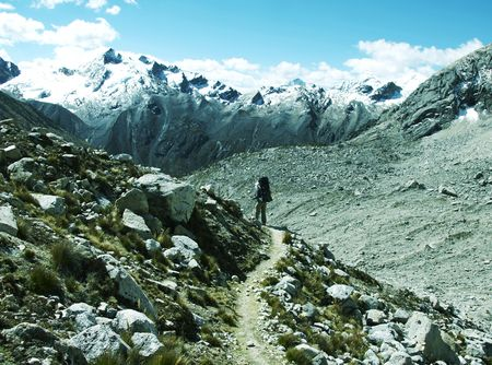 alpamayo: Backpacker going up in Cordilleras mountain