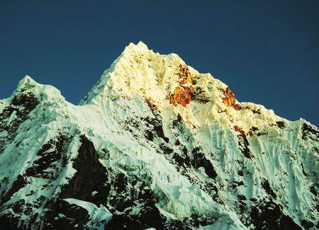alpamayo: High summit Alpamayo in Cordilleras Stock Photo