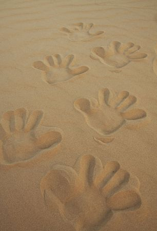 Hands step in sand photo